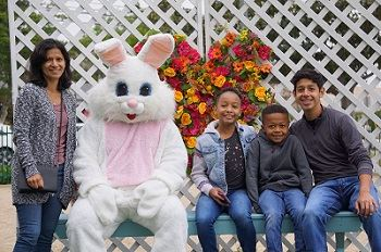 Spring Celebration Photo, family sitting with Mr.Bunny