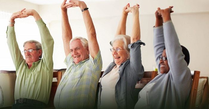 Health and Wellness - Older adults stretching their arms.