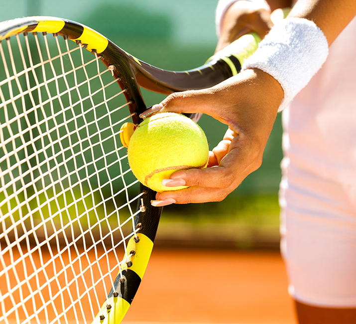 Tennis, a ball and racquet
